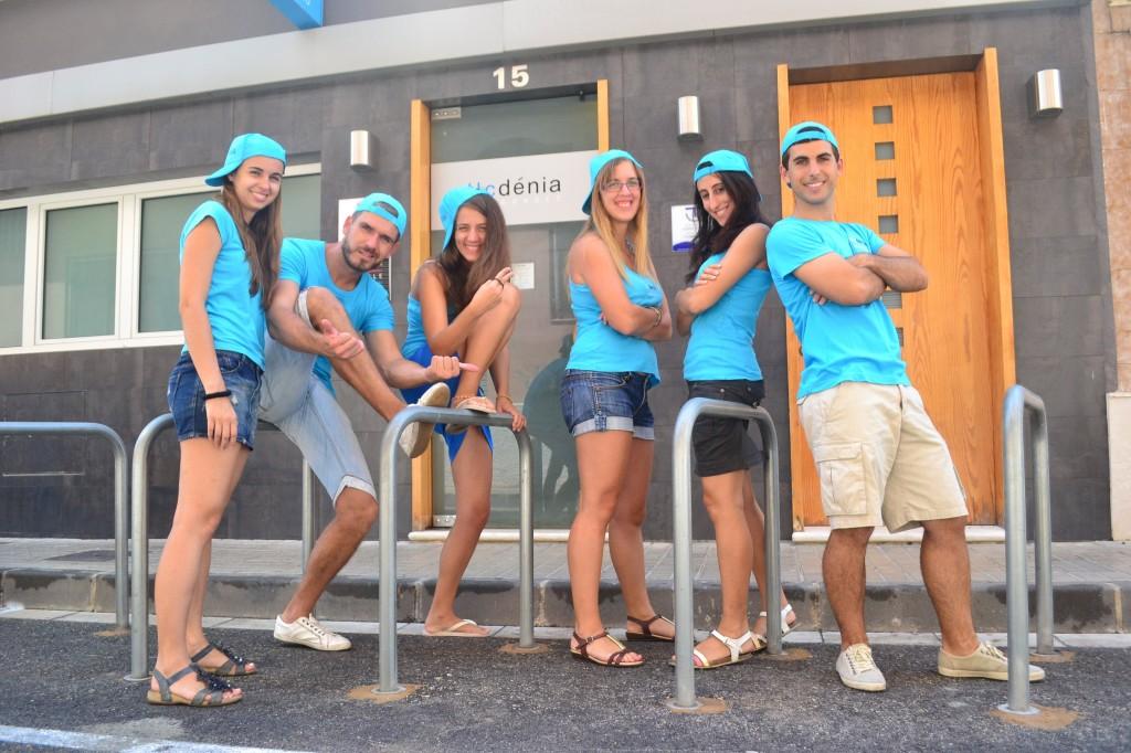 Instructors of TLCdenia at the door of the school