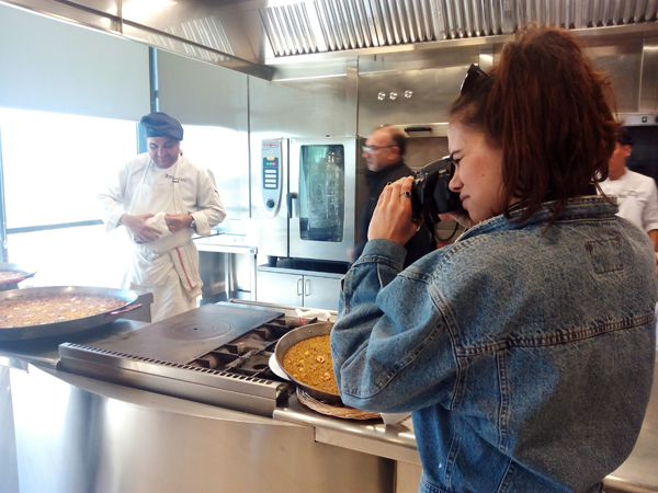 Student taking pictures while cooking a rice to band in the CDT