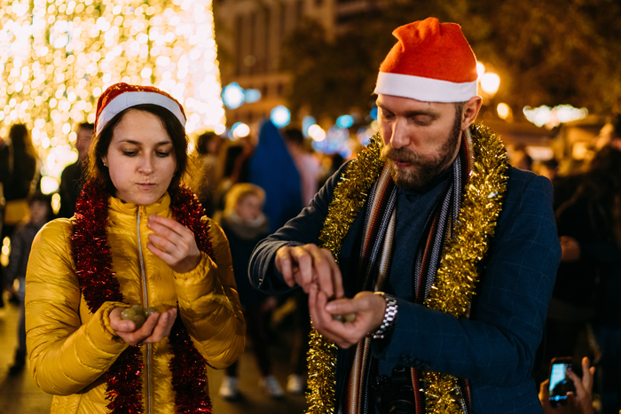 Couple in Spain eating grapes at midnight on New Year's eve