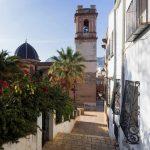 Street with the main church of Denia in Spain
