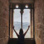 Girl in a window of Denia's castle in Spain