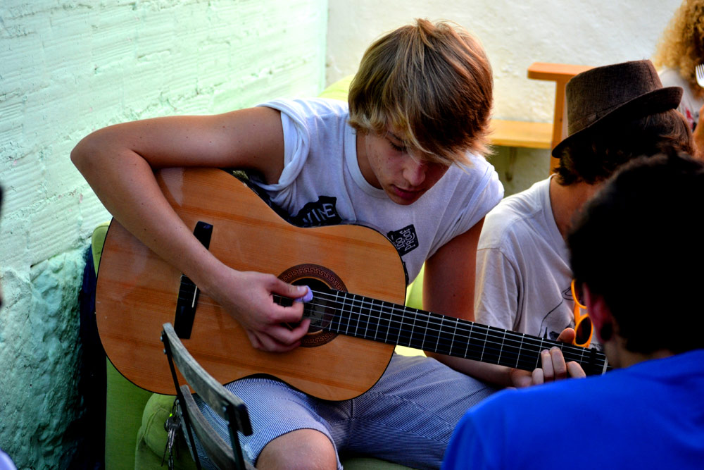 spanish student in spain playing guitar