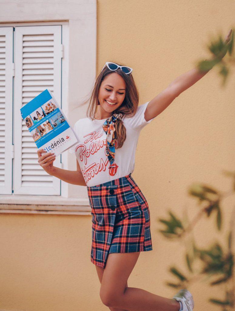 A student of Spanish with a TLCdénia folder