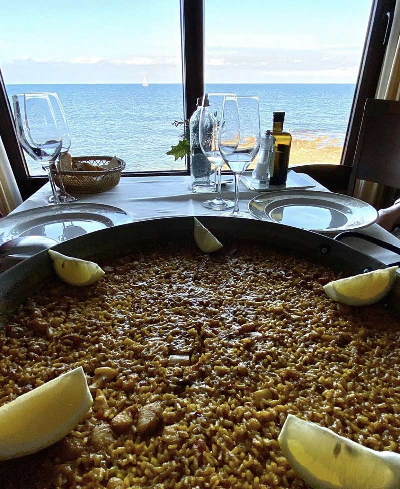Paella in front of the sea