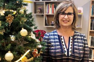 TLCdénia School of Spanish director the director next to the Christmas tree